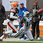 New York Jets wide receiver Santonio Holmes (10) cannot catch a pass against Cleveland Browns cornerback Eric Wright (21) in the second quarter of an NFL football game Sunday, Nov. 14, 2010, ...
