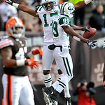 New York Jets wide receiver Braylon Edwards (17) celebrates with teammate Jerricho Cotchery (89) after Cotchery's 25-yard touchdown-catch in the second quarter of an NFL football game agains ...