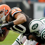 Cleveland Browns running back Peyton Hillis is brought down by New York Jets linebacker Bart Scott (57) after a short gain in the first quarter of an NFL football game Sunday, Nov. 14, 2010, ...