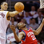 Cleveland Cavaliers center Ryan Hollins (5) knocks the ball loose from Philadelphia 76ers forward Thaddeus Young (21) as Young goes to the basket in the third quarter in an NBA basketball ga ...