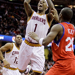 Cleveland Cavaliers guard Daniel Gibson (1) shoots in front of Philadelphia 76ers guard Jodie Meeks in the fourth quarter in an NBA basketball game Tuesday, Nov. 16, 2010, in Cleveland. Gibs ...