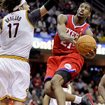 Philadelphia 76ers forward Thaddeus Young (21) jumps to the basket against Cleveland Cavaliers forward Anderson Varejao, from Brazil, in the third quarter of an NBA basketball game Tuesday,  ...