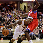 Cleveland Cavaliers guard Daniel Gibson, left, drives past Philadelphia 76ers guard Jrue Holiday in the fourth quarter in an NBA basketball game Tuesday, Nov. 16, 2010, in Cleveland. Gibson  ...