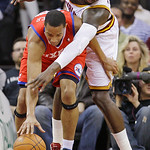 Cleveland Cavaliers forward J.J. Hickson, back, tries to knock the ball loose from Philadelphia 76ers guard Evan Turner in the first quarter in an NBA basketball game Tuesday, Nov. 16, 2010, ...