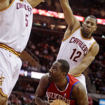 Philadelphia 76ers forward Elton Brand tries to get past Cleveland Cavaliers center Ryan Hollins (5) and guard Joey Graham (12) in the first quarter in an NBA basketball game Tuesday, Nov. 1 ...