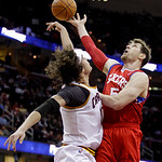 Cleveland Cavaliers forward Anderson Varejao, left, from Brazil, knocks the ball loose from Philadelphia 76ers forward Andres Nocioni, from Argentina, in the first quarter in an NBA basketba ...