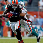 Cleveland Browns safety Abram Elam (26) is tackled by Miami Dolphins tight end Anthony Fasano, behind, after coming up with an interception in the second quarter during an NFL football game  ...
