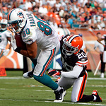 Miami Dolphins tight end Anthony Fasano (80) scores a touchdown as Cleveland Browns cornerback Mike Adams (20) defends in the fourth quarter during an NFL football game in Miami, Sunday, Dec ...