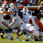 Miami Dolphins kicker Dan Carpenter, left, kicks a 60-yard field goal in the second quarter during an NFL football game against the Cleveland Browns in Miami, Sunday, Dec. 5, 2010. (AP Photo ...
