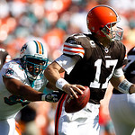 Cleveland Browns quarterback Jake Delhomme (17) is pressured by Miami Dolphins linebacker Quentin Moses, left, in the second quarter during an NFL football game in Miami, Sunday, Dec. 5, 201 ...