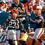 Cleveland Browns linebacker Eric Barton (50) jumps into the arms of defensive tackle Shaun Rogers (92) after Rogers blocked a field goal-attempt by Miami Dolphins kicker Dan Carpenter (not s ...