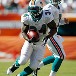 Miami Dolphins running back Ricky Williams (34) runs as quarterback Chad Henne (7) looks on in the first quarter of an NFL football game against the Cleveland Browns in Miami, Sunday, Dec. 5 ...