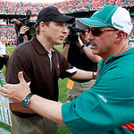 Cleveland Browns head coach Eric Mangini, left, meets with Miami Dolphins head coach Tony Sparano, right, after the Browns defeated the Dolphins 13-10 in an NFL football game in Miami, Sunda ...