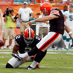 Cleveland Browns kicker Phil Dawson (4) boots the game-winning field goal in the fourth quarter during an NFL football game against the Miami Dolphins in Miami, Sunday, Dec. 5, 2010. Punter  ...