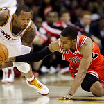 Chicago Bulls' C.J. Watson tries to knock the ball loose from Cleveland Cavaliers' Mo Williams in the third quarter of an NBA basketball game Wednesday, Dec. 8, 2010, in Cleveland. The Bulls ...
