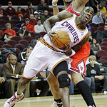 Cleveland Cavaliers' Antawn Jamison, front, tries to get past Chicago Bulls' Carlos Boozer in the first quarter of an NBA basketball game, Wednesday, Dec. 8, 2010, in Cleveland. (AP Photo/To ...