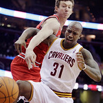 Cleveland Cavaliers forward Jawad Williams (31) is fouled by Chicago Bulls' Omer Asik , from Turkey, during the first half of an NBA basketball game, Wednesday, Dec. 8, 2010, in Cleveland. ( ...