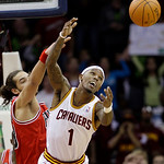 Cleveland Cavaliers' Daniel Gibson (1) and Chicago Bulls' Joakim Noah watch the ball get away during the fourth quarter in an NBA basketball game Wednesday, Dec. 8, 2010, in Cleveland. The B ...