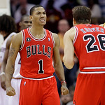 Chicago Bulls' Derrick Rose (1) reacts as he looks at teammate Kyle Korver (26) after Rose was fouled in the fourth quarter of an NBA basketball game against the Cleveland Cavaliers, Wednesd ...