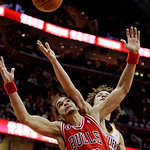 Chicago Bulls' Joakim Noah (13) and Cleveland Cavaliers' Anderson Varejao, from Brazil, battle for a loose ball during the fourth quarter of an NBA basketball game, Wednesday, Dec. 8, 2010,  ...