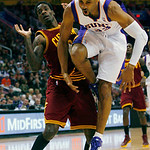 Cleveland Cavaliers' Manny Harris reacts as Phoenix Suns' Grant Hill falls to the floor during the first half of an NBA basketball game on Sunday, Jan. 9, 2011, in Phoenix. (AP Photo/The Ari ...