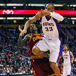 Cleveland Cavaliers' Manny Harris falls back as Phoenix Suns' Grant Hill falls to the floor during the first half of an NBA basketball game on Sunday, Jan. 9, 2011, in Phoenix. (AP Photo/The ...