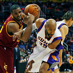Cleveland Cavaliers' Samardo Samuels and Phoenix Suns' Vince Carter get tangled up during the first half of an NBA basketball game on Sunday, Jan. 9, 2011, in Phoenix. (AP Photo/The Arizona  ...