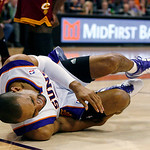 Phoenix Suns' Grant Hill falls to the floor after being injured during the first half of an NBA basketball game against the Cleveland Cavaliers on  Sunday, Jan. 9, 2011, in Phoenix. (AP Phot ...