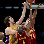 Los Angeles Lakers forward Pau Gasol, left, of Spain, and Cleveland Cavaliers forwards Antawn Jamison, center, and Samardo Samuels reach for a rebound during the first half of an NBA basketb ...