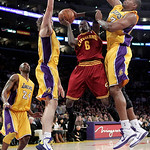 Cleveland Cavaliers guard Manny Harris, center, looks for a shot between Los Angeles Lakers' Pau Gasol, of Spain, and Andrew Bynum, right, during the first half of an NBA basketball game in  ...
