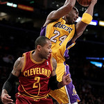 Los Angeles Lakers guard Kobe Bryant, top, gets a rebound against Cleveland Cavaliers guard Mo Williams during the first half of an NBA basketball game in Los Angeles, Tuesday, Jan. 11, 2011 ...
