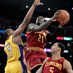 Cleveland Cavaliers power forward J.J. Hickson, center, goes up for a basket as he is defended by Los Angeles Lakers center Andrew Bynum during the first half of an NBA basketball game in Lo ...