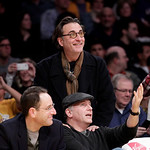 Actor Andy Garcia, top, talks to comedian Paul Reiser while watching an NBA basketball game between the Los Angeles Lakers and the Cleveland Cavaliers in Los Angeles, Tuesday, Jan. 11, 2011. ...