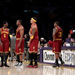 Cleveland Cavaliers guard Manny Harris, from left, Samardo Samuels, Jamario Moon, Alonzo Gee and Ramon Sessions stand on the court during the second half of an NBA basketball game with the L ...