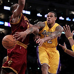 Los Angeles Lakers point guard Shannon Brown, right, passes the ball as he is defended by Cleveland Cavaliers power forward Samardo Samuels during the second half of an NBA basketball game i ...