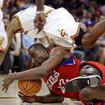 Philadelphia 76ers' Elton Brand, bottom, grabs a loose ball ahead of Cleveland Cavaliers' Ramon Sessions in the third quarter of an NBA basketball game Sunday, Feb. 27, 2011, in Cleveland. T ...