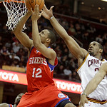 Philadelphia 76ers' Evan Turner (12) jumps to the basket against Cleveland Cavaliers' Samardo Samuels (24) in the third quarter in an NBA basketball game Sunday, Feb. 27, 2011, in Cleveland. ...