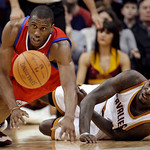 Philadelphia 76ers' Thaddeus Young, left, and Cleveland Cavaliers' J.J. Hickson battle for a loose ball in the fourth quarter of an NBA basketball game on Sunday, Feb. 27, 2011, in Cleveland ...