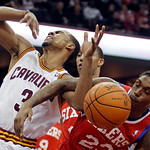 Philadelphia 76ers' Lou Williams (23) fouls Cleveland Cavaliers' Ramon Sessions (3) in the second quarter of an NBA basketball game Sunday, Feb. 27, 2011, in Cleveland. (AP Photo/Tony Dejak)