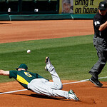 Oakland Athletics third baseman Kevin Kouzmanoff dives for a double by Cleveland Indians' Shelley Duncan as third base umpire Clint Fagan gets out of the way during the fourth inning of a sp ...