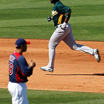 Oakland Athletics' Chris Carter round the bases after a home run off Cleveland Indians pitcher Jeanmar Gomez during the sixth inning of a spring training baseball game in Goodyear, Ariz., Mo ...