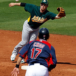 Cleveland Indians' Shin-Soo Choo advances to second as Oakland Athletics second baseman Eric Sogard can't catch the throw on a ball hit by Austin Kearns during the third inning of a spring t ...