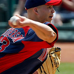 Cleveland Indians starting pitcher Justin Masterson throws to the Oakland Athletics during the first inning of a spring training baseball game in Goodyear, Ariz., Monday, March 14, 2011. (AP ...