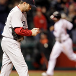 Boston Red Sox relief pitcher Dan Wheeler, left, waits for runners to score after Cleveland Indians' Asdrubal Cabrera hit a three-run home run in the sixth inning in a baseball game, Wednesd ...
