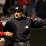 Home plate umpire Dale Scott, right, tells Boston Red Sox catcher Jason Varitek that Cleveland Indians' Travis Buck is safe at home plate in the sixth inning in a baseball game, Wednesday, A ...