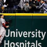 Boston Red Sox right fielder J.D. Drew jumps high but cannot reach a three-run home run hit by Cleveland Indians' Asdrubal Cabrera in the sixth inning in a baseball game, Wednesday, April 6, ...