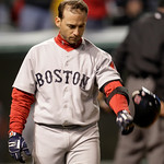 Boston Red Sox's Marco Scutaro throws his helmet after striking out in the sixth inning in a baseball game against the Cleveland Indians, Wednesday, April 6, 2011, in Cleveland. (AP Photo/To ...