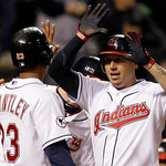 Cleveland Indians' Asdrubal Cabrera, right, is congratulated by teammates after hitting a three-run home run in the sixth inning of a baseball game against the Boston Red Sox on Wednesday, A ...