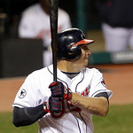 Cleveland Indians' Asdrubal Cabrera watches his RBI single off Boston Red Sox starting pitcher Daisuke Matsuzaka in the second inning of a baseball game Wednesday, April 6, 2011, in Clevelan ...