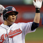 Cleveland Indians' Shin-Soo Choo is congratulated by teammates after hitting a two-run home run off Boston Red Sox's Daisuke Matsuzaka in the first inning of a baseball game Wednesday, April ...